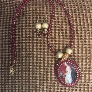 Red Queen beaded necklace with matching earrings.